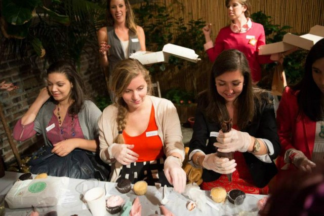 Ladies at table creating cupcakes